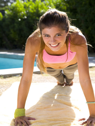 woman exercising pushup